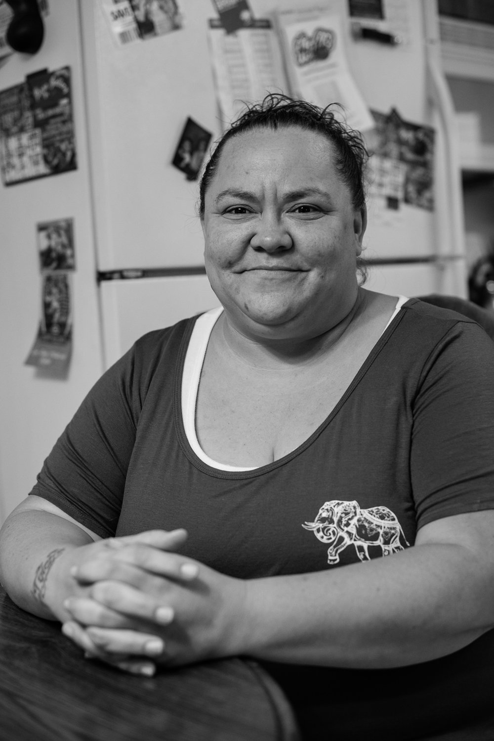 """Maria in her kitchen after our interview. Maria now serves as Director of Case Management for a local social services agency. """"I learned that we had to work. We had to do our part and be a productive member of society."""""""