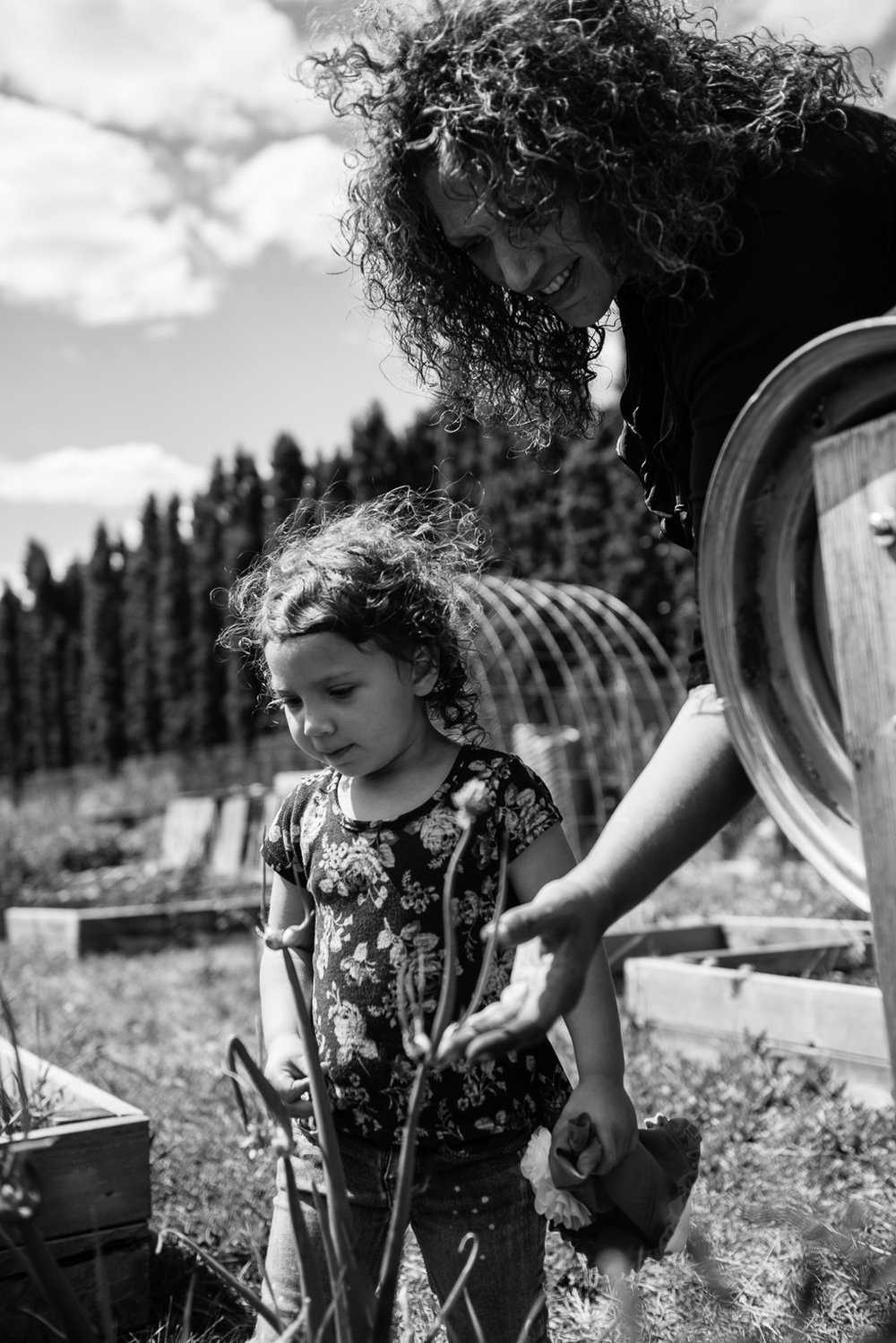 """Carmen and her granddaughter at the community garden where they grow vegetables.  Says Carmen """"  It's really great to see – I really feel like we've broken that third-generation cycle of being involved within the child welfare system. Having that complex trauma. My children who have children are successfully parenting. They work, they go to school. They are upstanding citizens. So somewhere along the line they were gifted and I'm very grateful for that."""""""