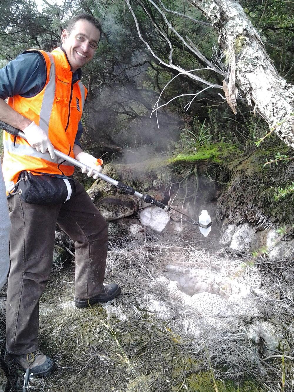 Matthew Stott sampling a small geothermal hotspring ( p1. 0999) at Orakei Korako