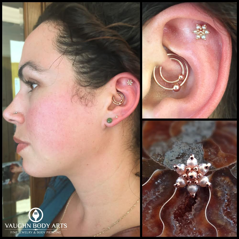 Helix piercing wth solid rose gold and pink pearl flower from BVLA. Also healed double daith piercings featuring 18k rose gold fixed bead rings from Anatometal.