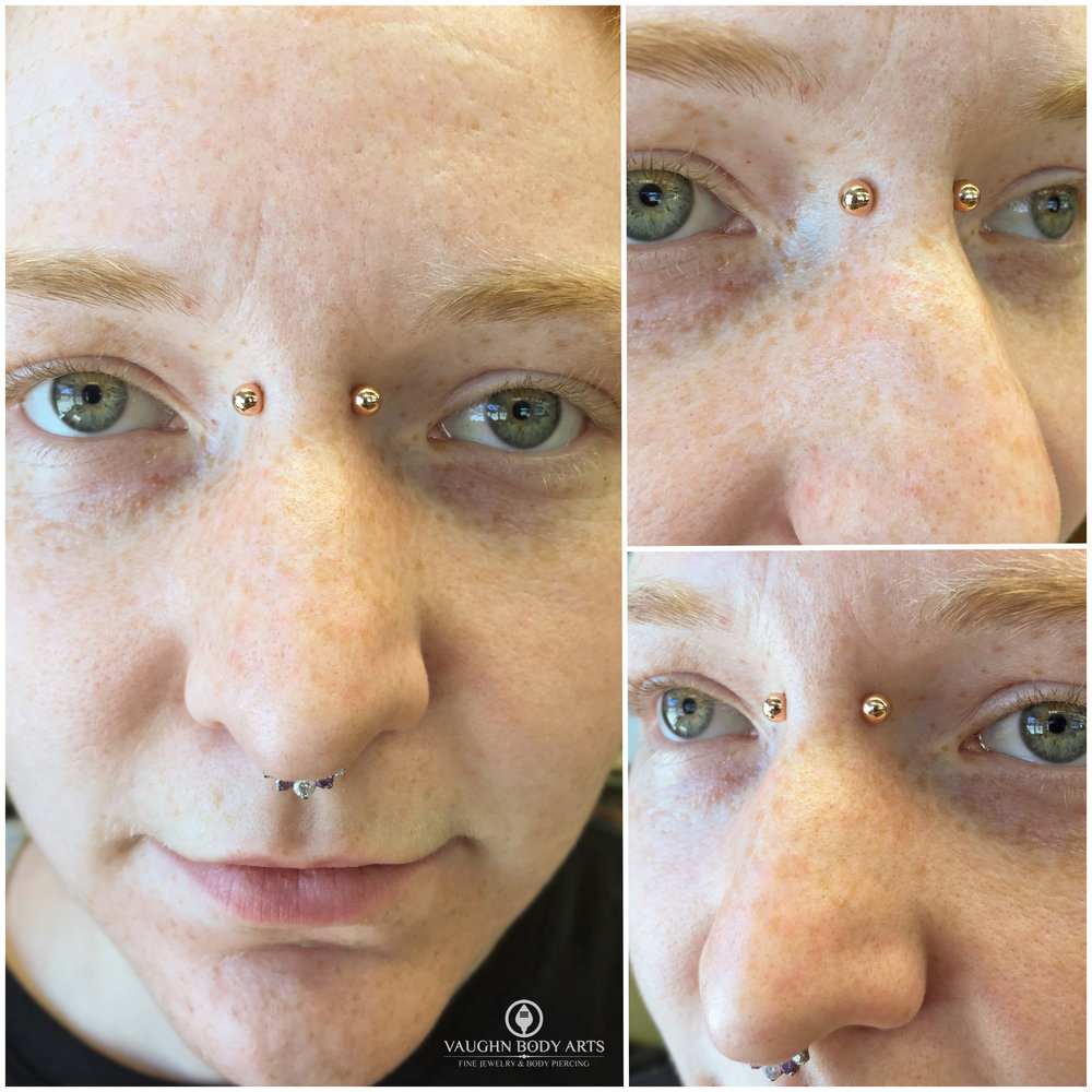 Bridge piercing with 18k rose gold jewelry from Anatometal.