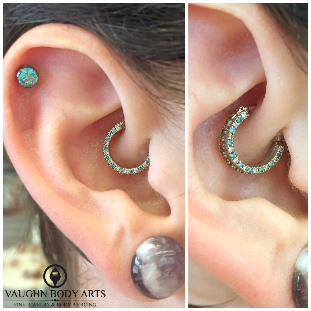 "Healed daith piercing featuring a 14k white gold ""Telesto Mandalay"" hinged ring with mint green and CZ gemstones."