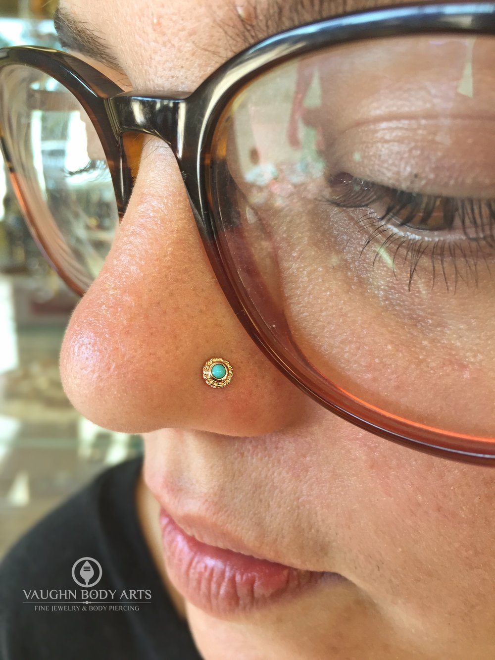"Nostril piercing with 14k yellow gold ""Choctaw"" end from BVLA."