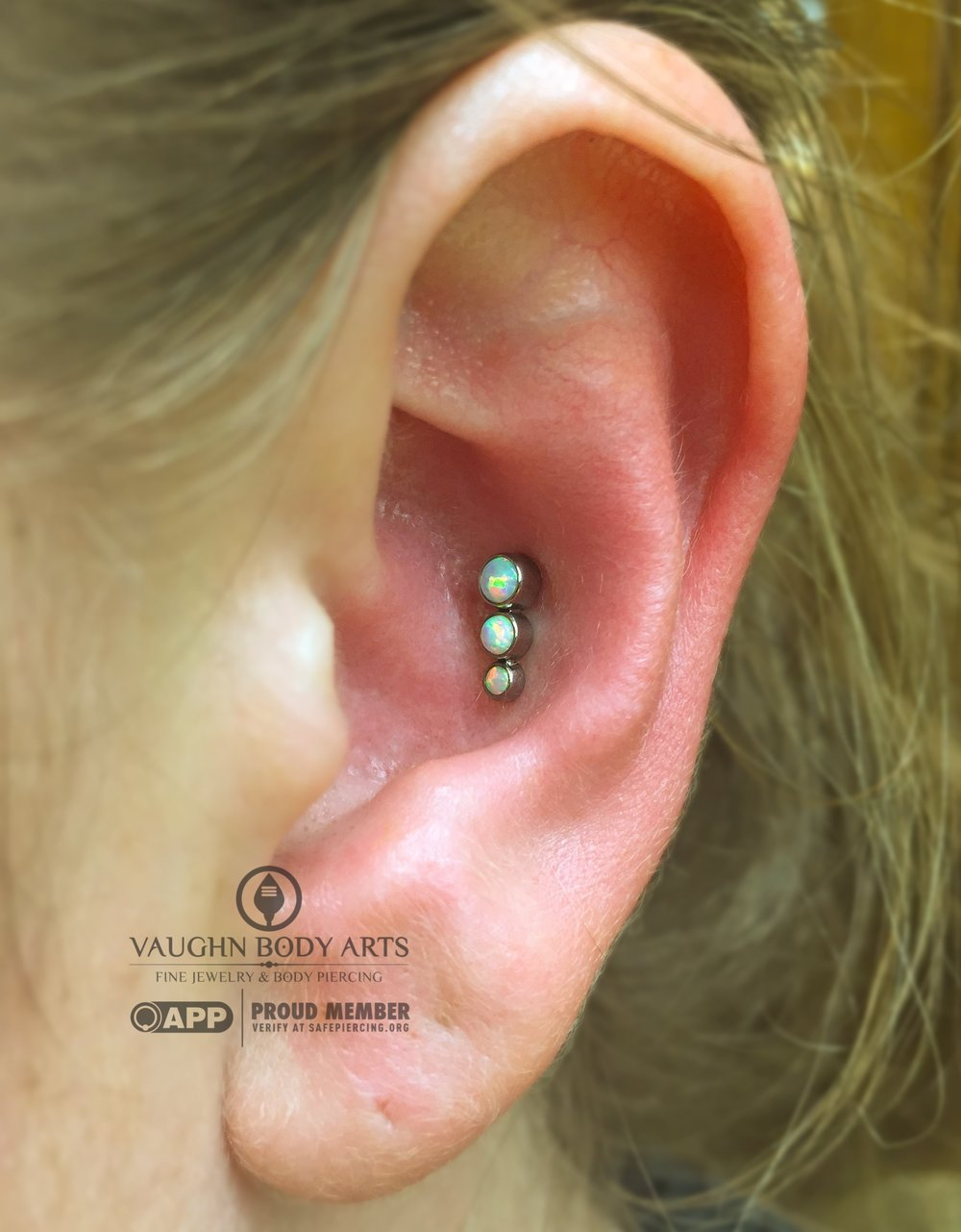 Conch piercing with titanium jewelry from Anatometal.