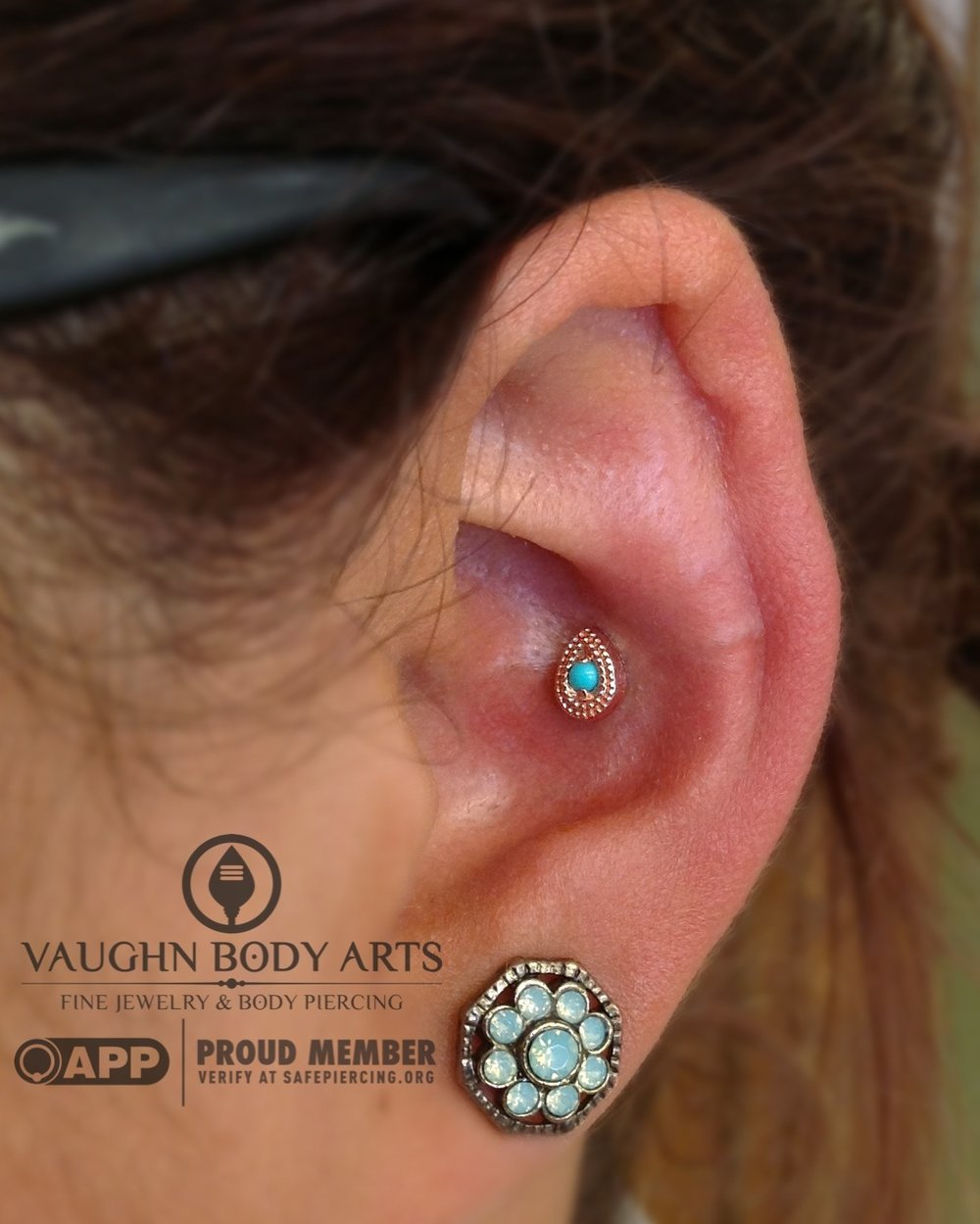 "Conch piercing featuring a 14k rose gold and turquoise ""Double Millgrain"" end from Scylla Jewelry."