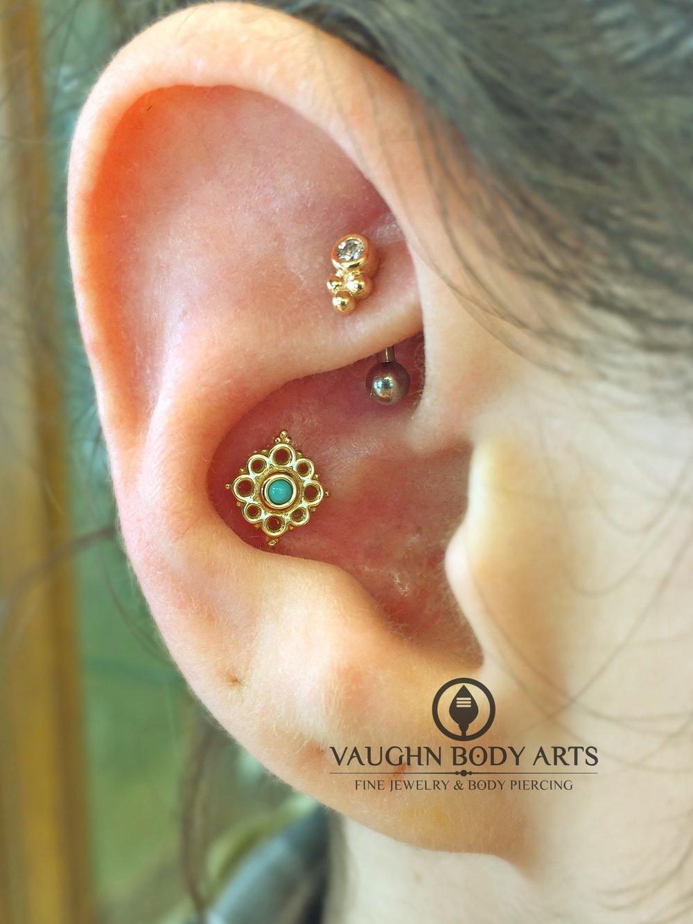 "Conch piercing with a 14k yellow gold and turquoise ""Angela"" end from BVLA."