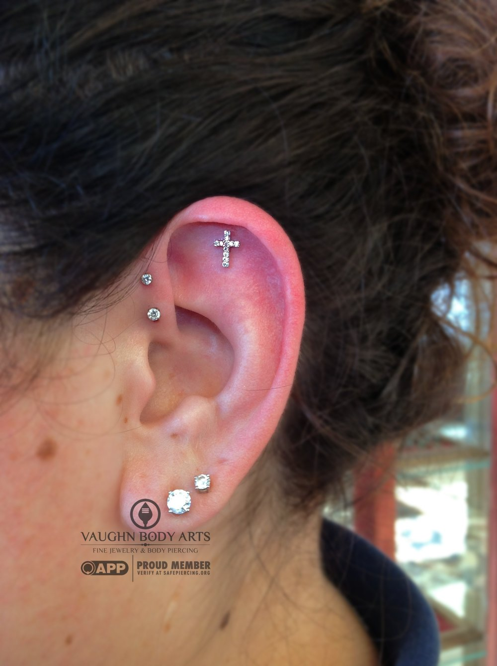 Helix piercing featuring a platinum and genuine diamond cross end from BVLA.