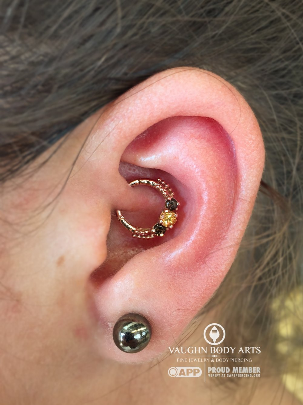 "Daith piercing featuring 14k rose gold ""Bumble"" hinged ring with genuine smokey quartz and yellow sapphire."