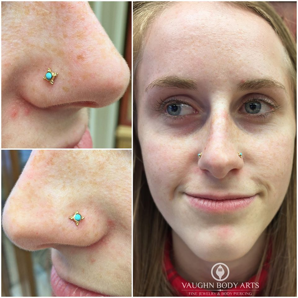 "Paired nostril piercings featuring 14k yellow gold and turquoise ""Mini Kandy"" ends from BVLA."