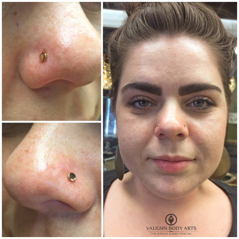 Paired nostril piercings with 18k rose gold disks from Anatometal.