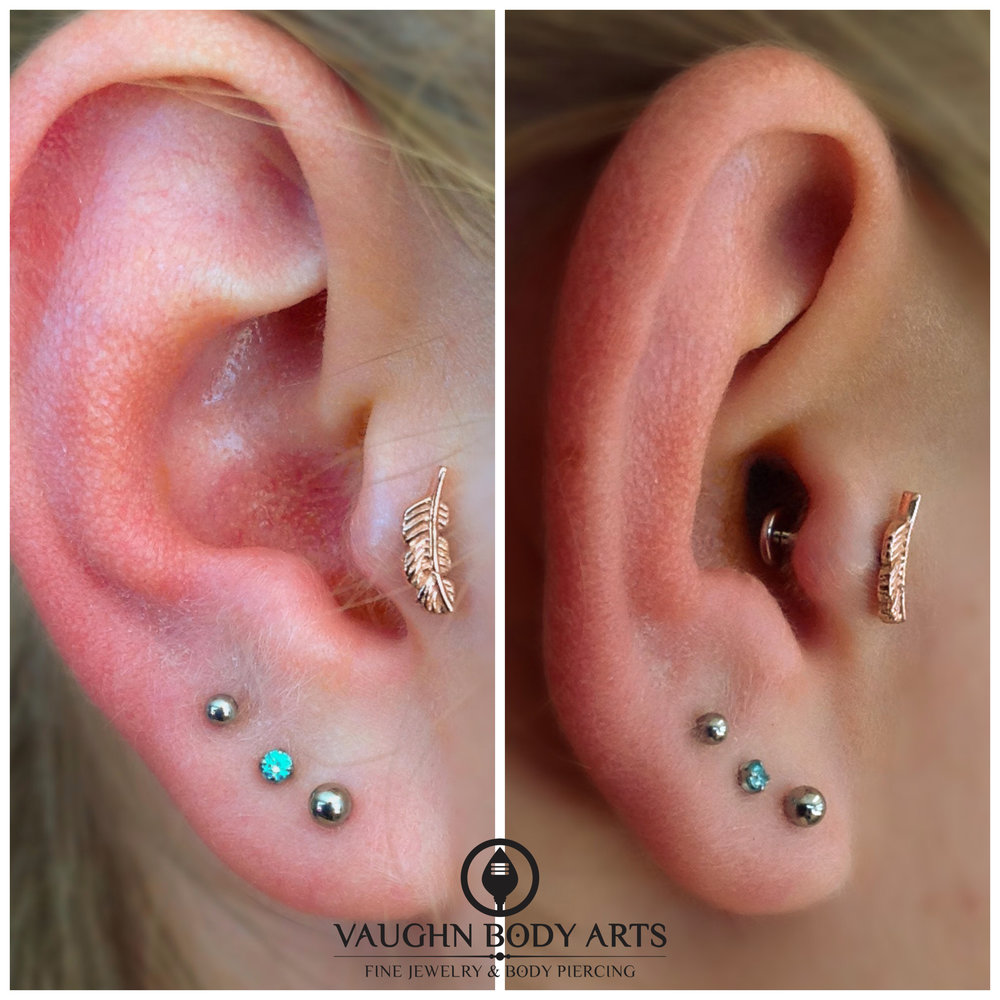 Tragus with a 14k yellow gold feather end from BVLA.