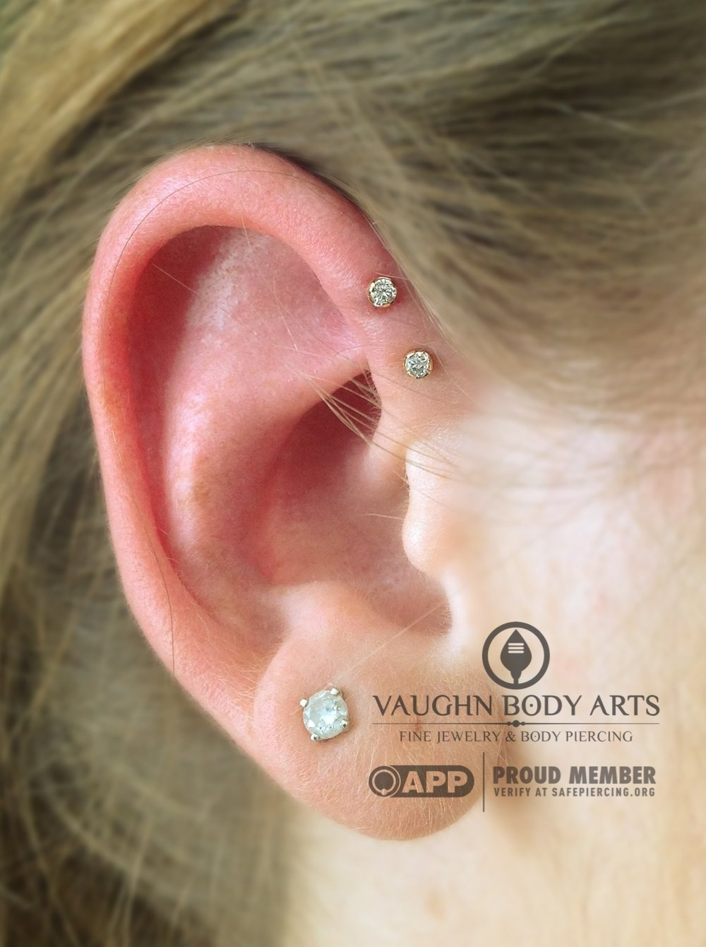 Double forward helix piercings with 18k yellow gold and genuine diamond jewelry from Anatometal.