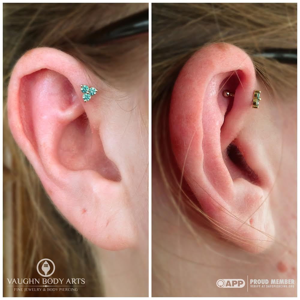 "Forward helix piercing with 14k yellow gold and mint green cz ""Trinity"" end from NeoMetal."