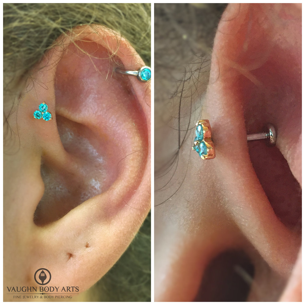 "Forward helix piercing with 18k yellow gold and mint green cz ""Trio"" end from Anatometal."
