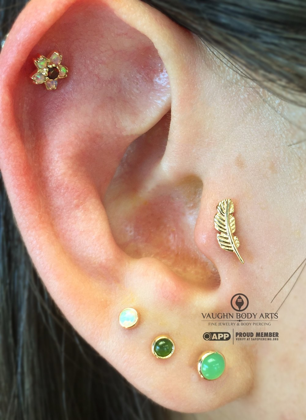 Tragus piercing with a 14k yellow gold feather end from BVLA.