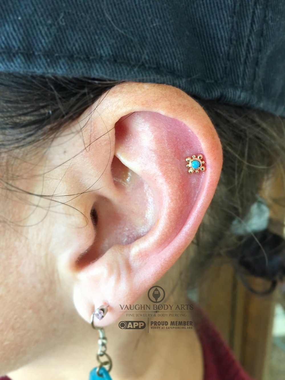 "Helix piercing with a 14k yellow gold and turquoise ""Bali"" end from NeoMetal."