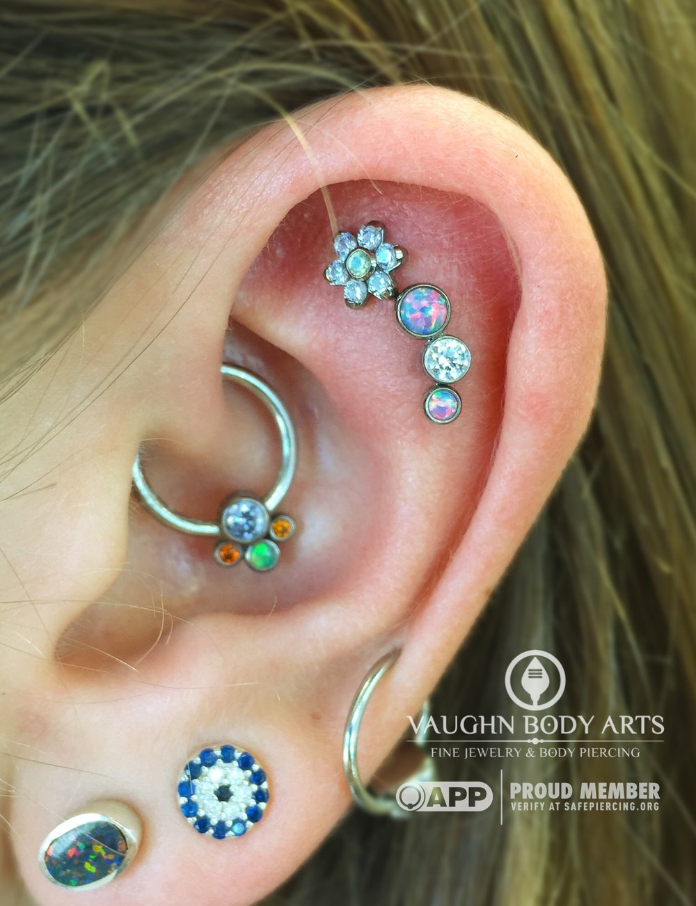 Helix piercings with titanium jewelry from Anatometal.