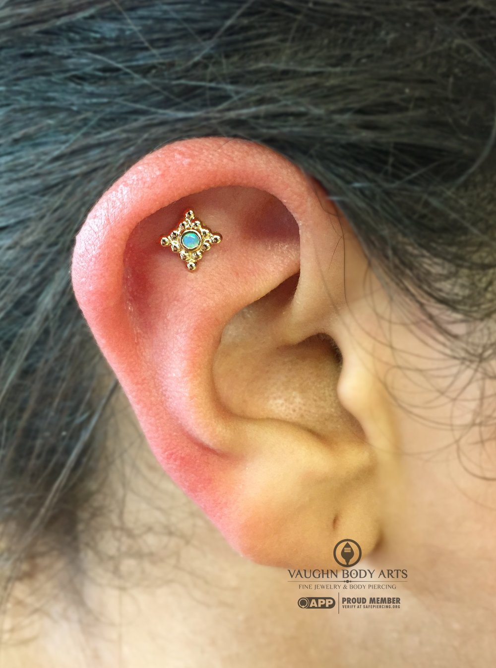 "Helix piercing featuring an 18k yellow gold ""Sabrina"" end from Anatometal."