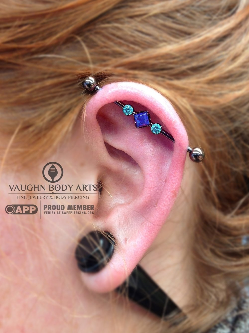 Industrial piercing with titanium jewelry from Anatometal.