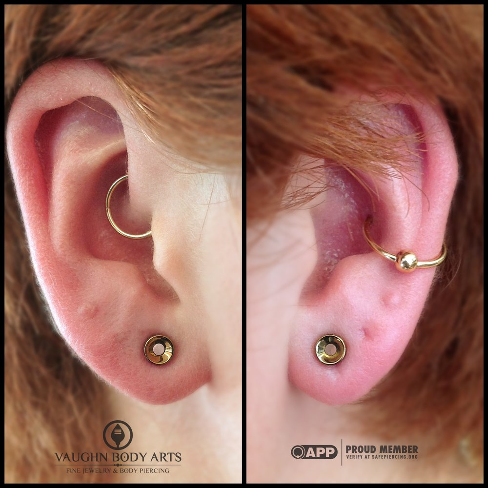 "Earlobe piercings with titanium eyelets from Anatometal, anodized ""bronze""."