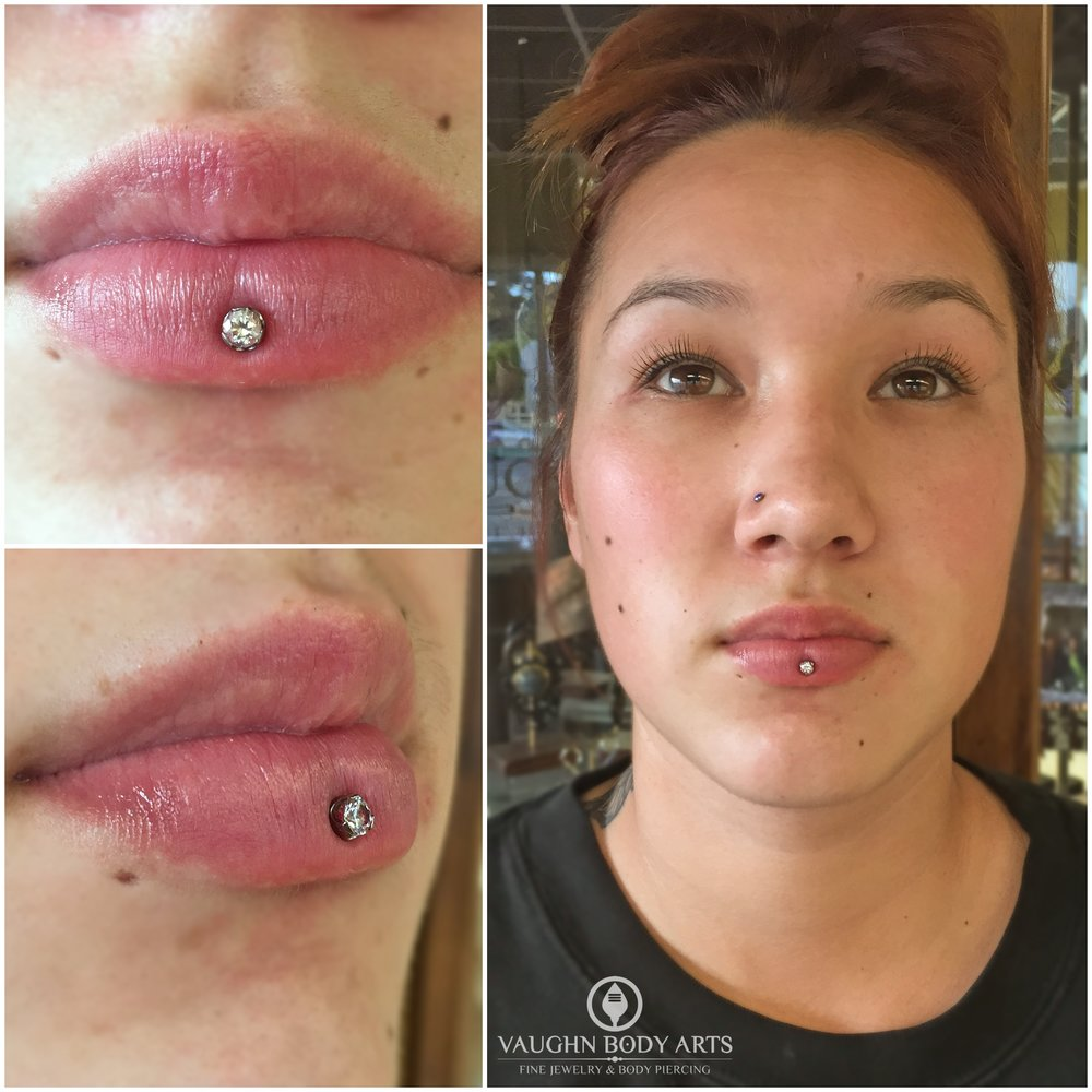 Inverse vertical labret piercing with titanium jewelry from Anatometal.