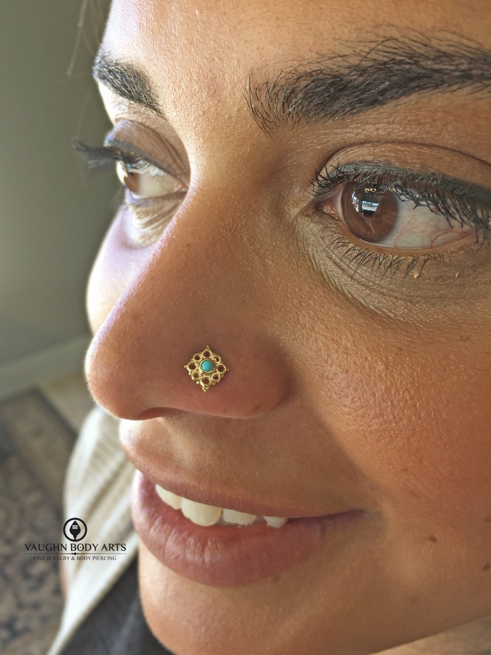 "Nostril piercing with 14k yellow gold and turquoise ""Angela"" end from BVLA."
