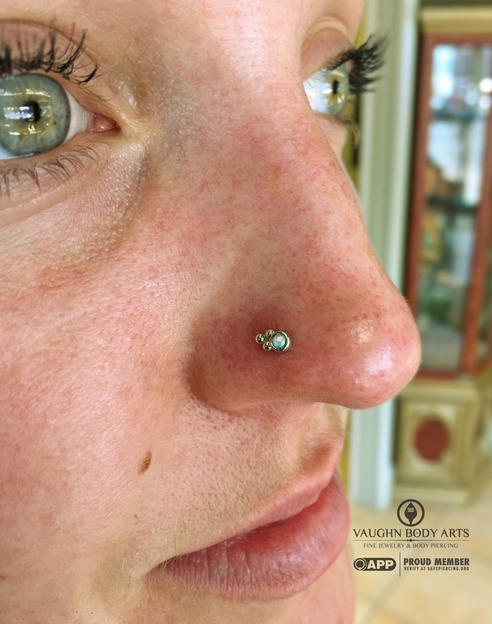 "Nostril piercing with an 18k white gold and opal ""Sabrina"" end from Anatometal."