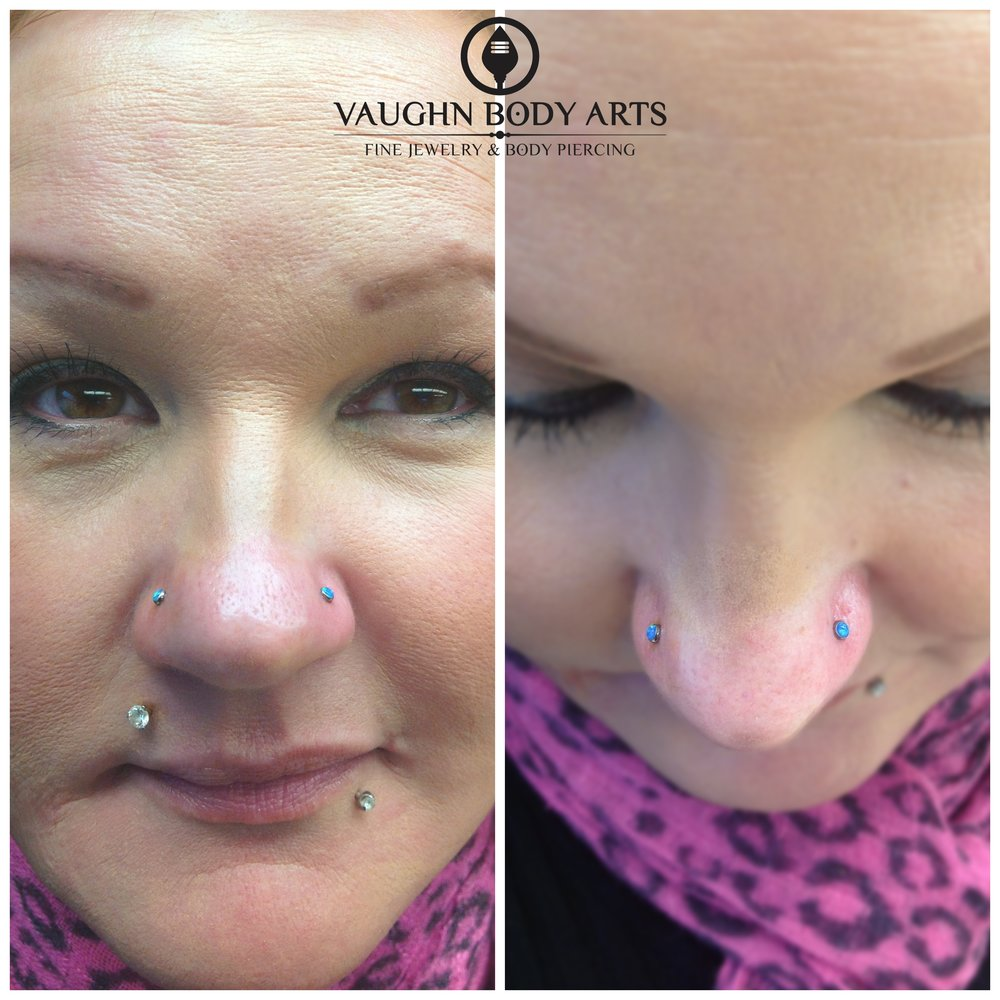 Paired nostril piercings with titanium jewelry from NeoMetal.