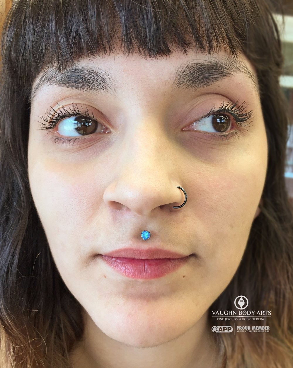 Philtrum piercing with titanium jewelry from Anatometal.