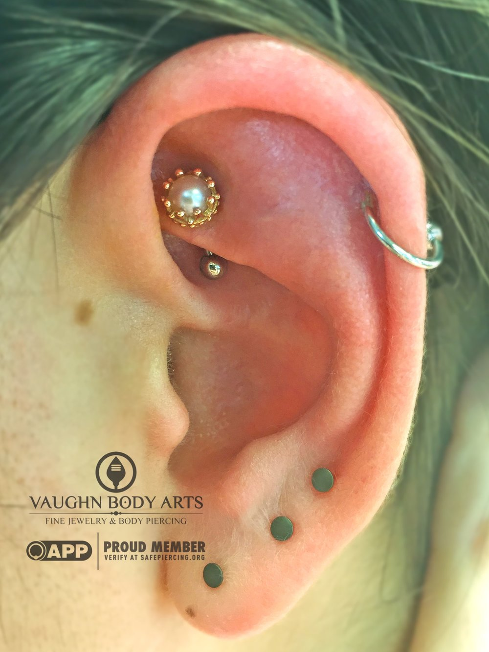 "Rook piercing with a 14k yellow gold ""Crown"" end featuring a genuine pearl from BVLA."