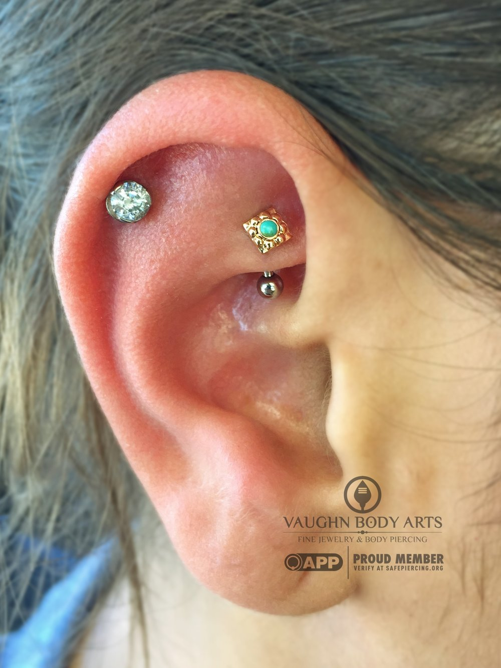 "Rook piercing with an 18k yellow gold and turquoise ""Kira"" end from Anatometal."