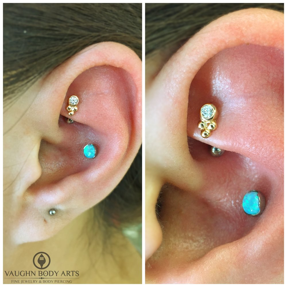 "Rook piercing with an 18k yellow gold and cz ""Sabrina"" end from Anatometal."