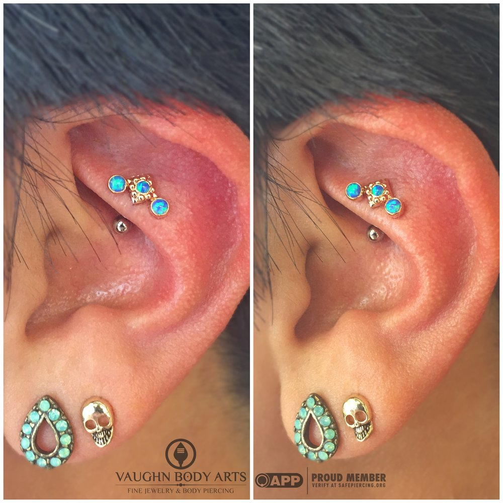 "Rook piercing with an 18k rose gold and opal ""Kira Cluster"" from Anatometal."