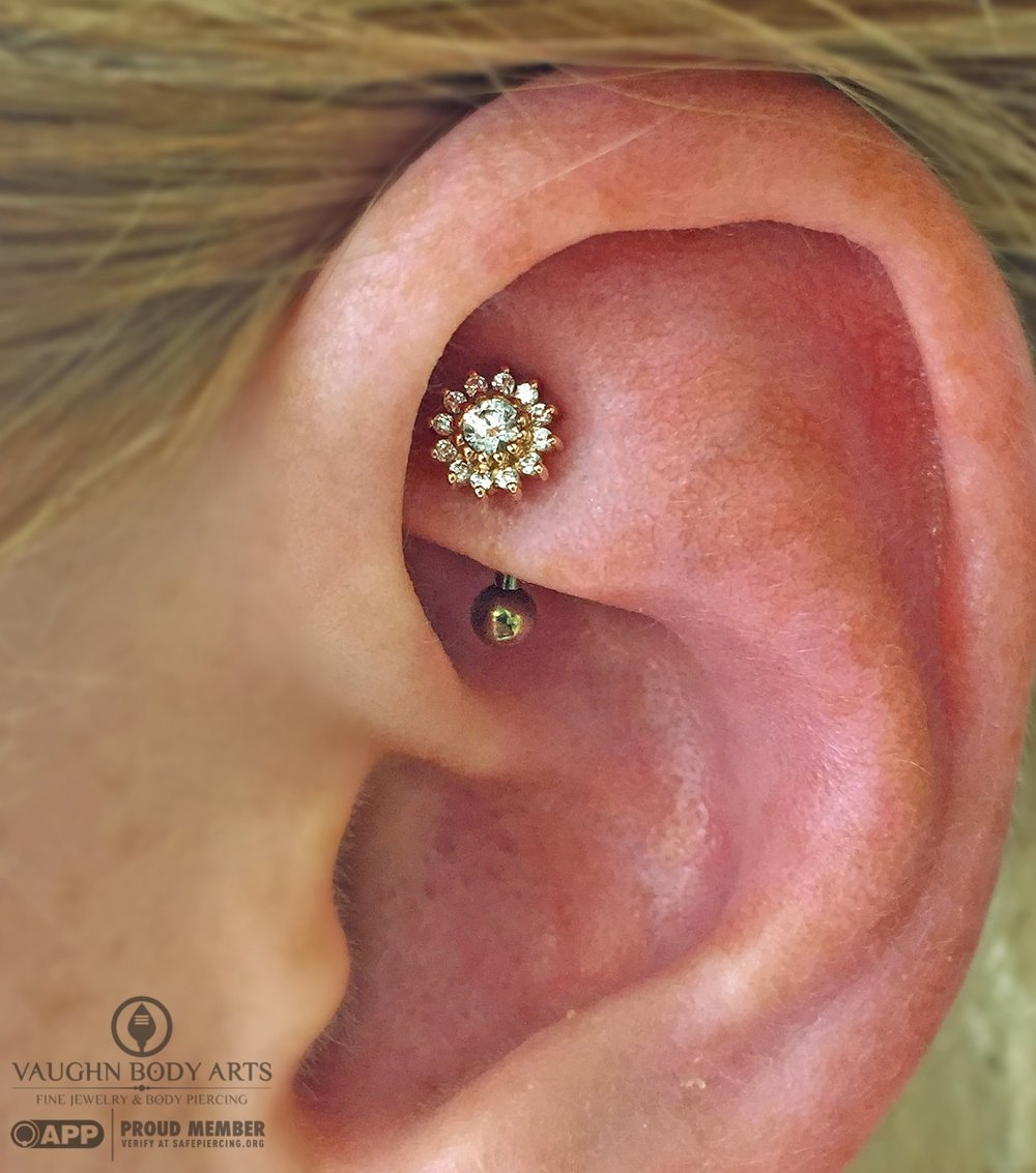 "Rook piercing with a 14k rose gold ""Rose"" end featuring clear cz's from BVLA."