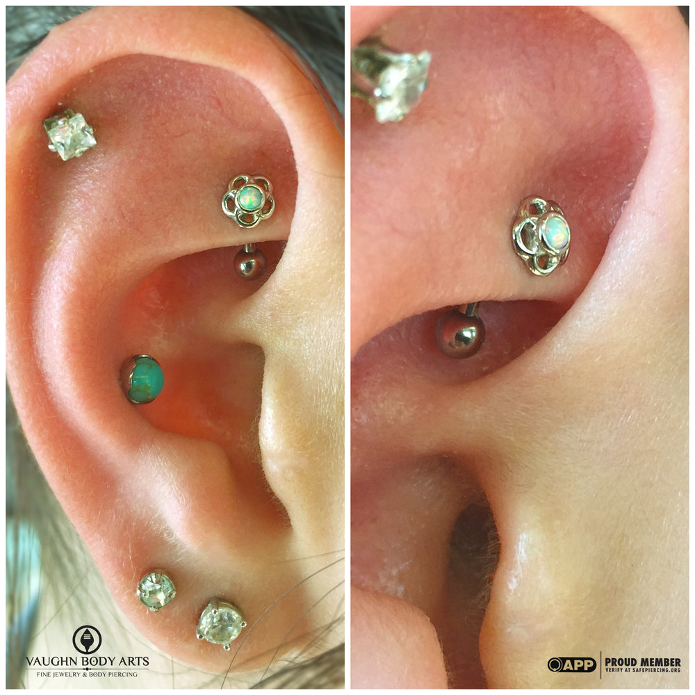 "Rook piercing with an 18k white gold and opal ""Tama"" end from Anatometal."