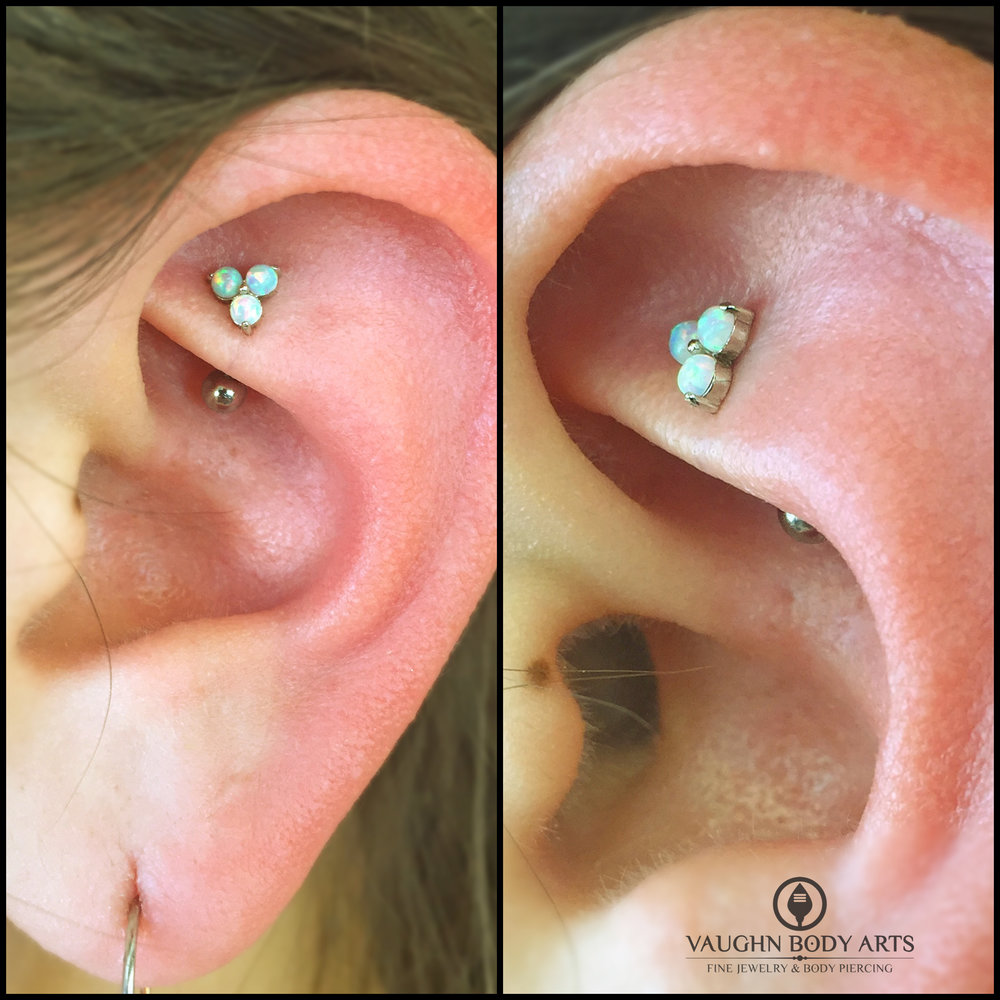 "Rook piercing with an 18k white gold and cz ""Trio"" end from Anatometal."