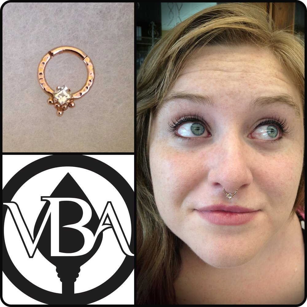 "Septum piercing with a 14k rose gold ""Miramyd"" hinged ring with white sapphire from Scylla Jewelry."
