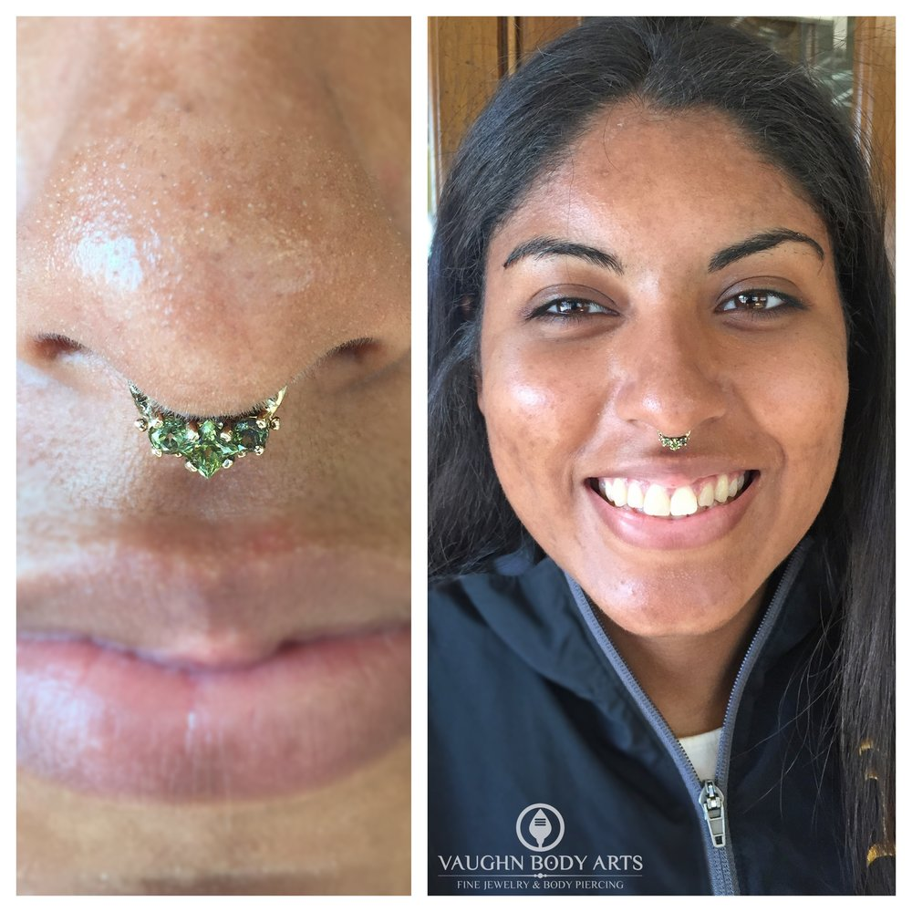"Septum piercing featuring a 14k yellow gold ""Baronet"" hinged ring with genuine peridot from Scylla Jewelry."