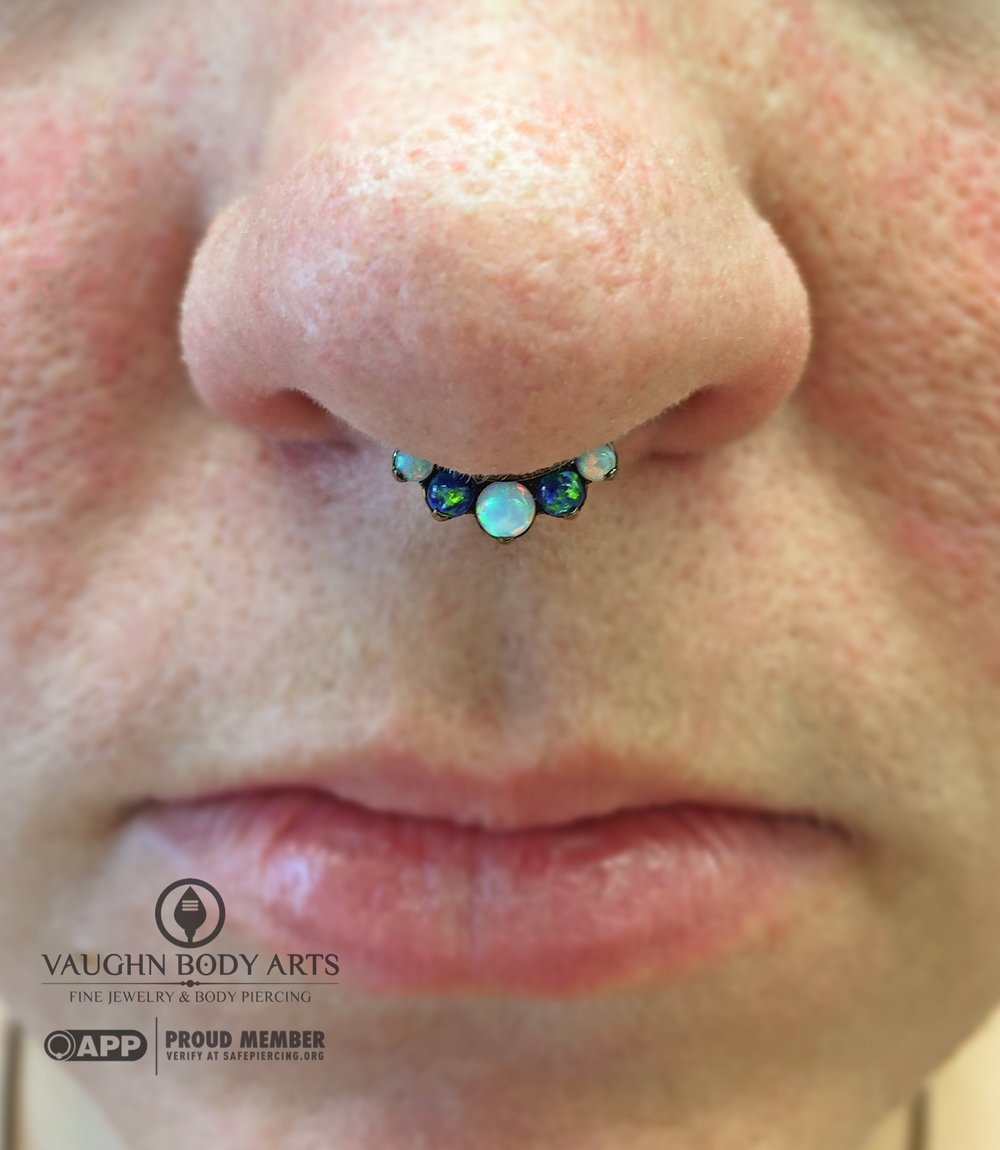 Septum piercing with titanium jewelry from Industrial Strength.