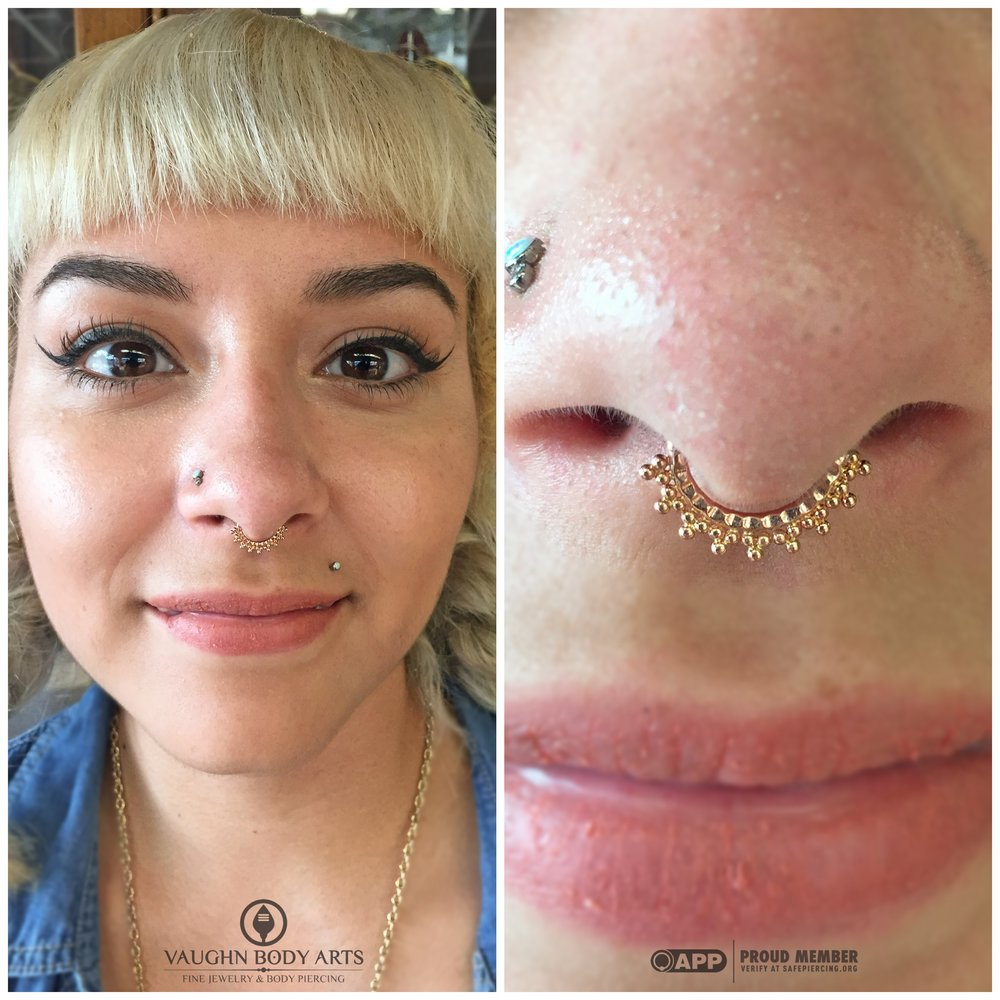 Septum piercing with 14k rose gold jewelry from Scylla Jewelry.