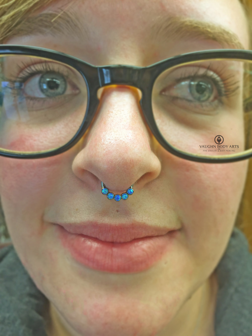 Septum piercing with titanium jewelry from Intrinsic Body.