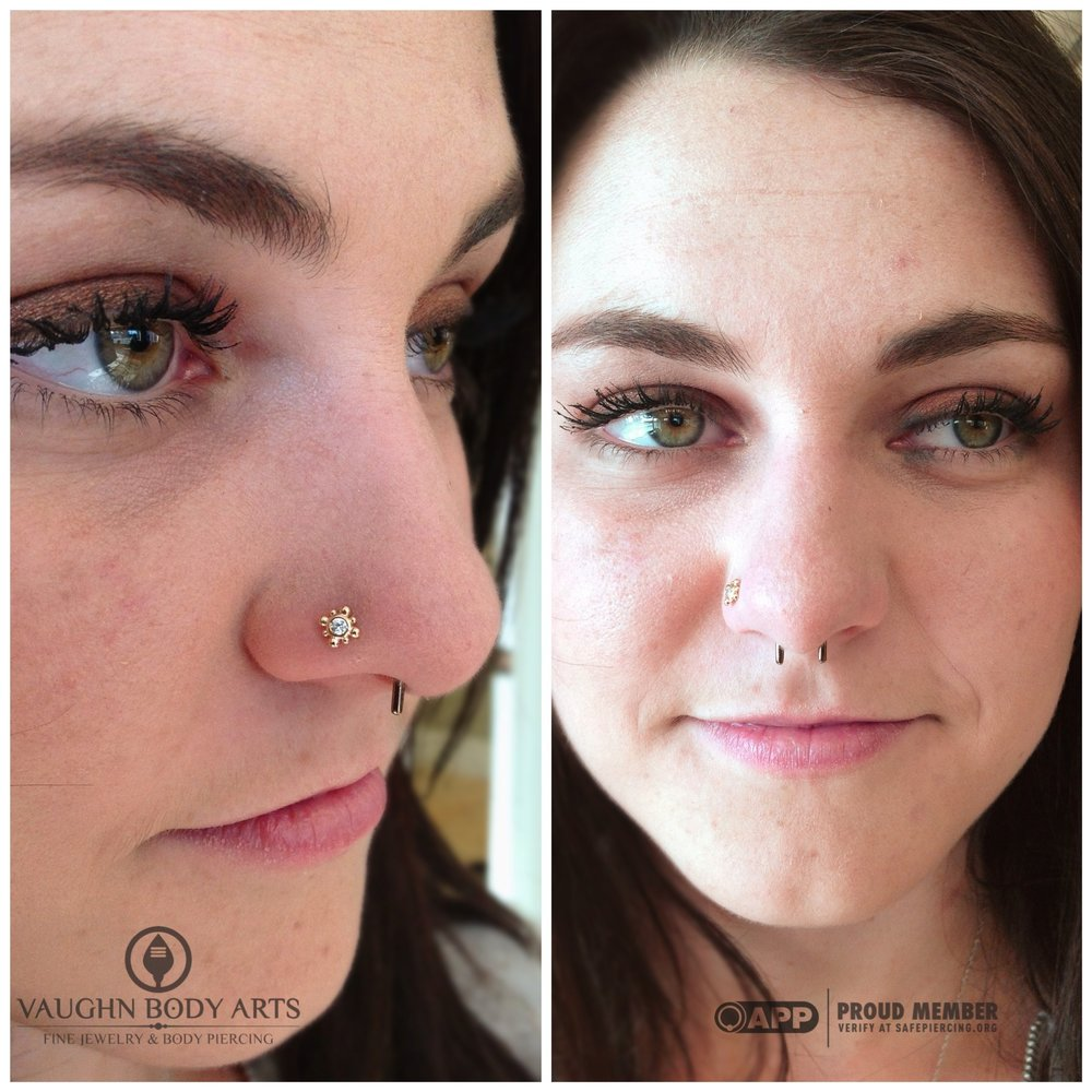 "Nostril piercing with a 14k yellow gold and cz ""Bali"" end from NeoMetal."