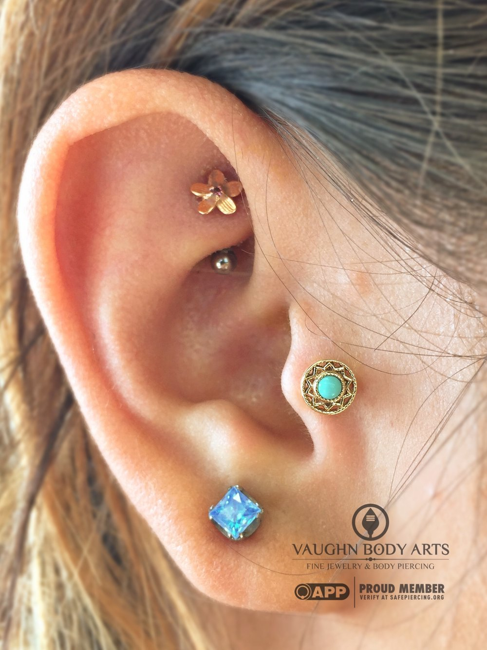 "Tragus piercing featuring a 14k yellow gold and turquoise ""Bandera"" end from BVLA."