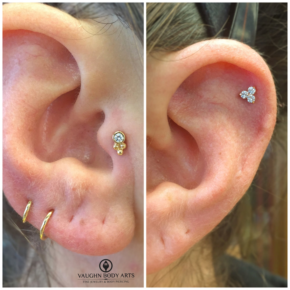 "Tragus piercing with an 18k yellow gold ""Sabrina"" end, helix with an 18k yellow gold ""Trio"" end. Jewelry from Anatometal."