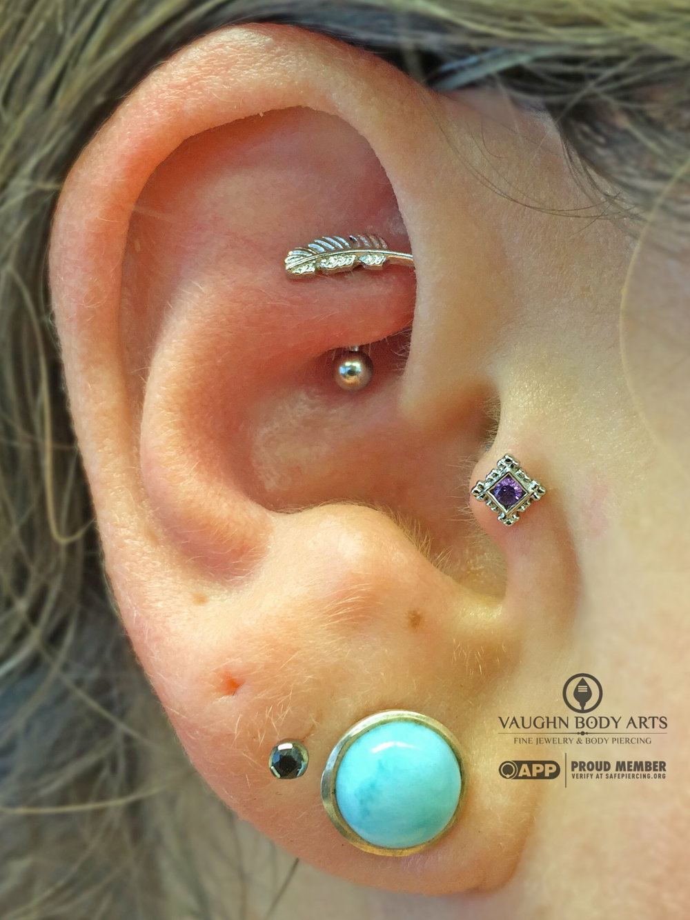 "Tragus piercing featuring a 14k white gold and amethyst ""Flourish Illusion"" end from BVLA."