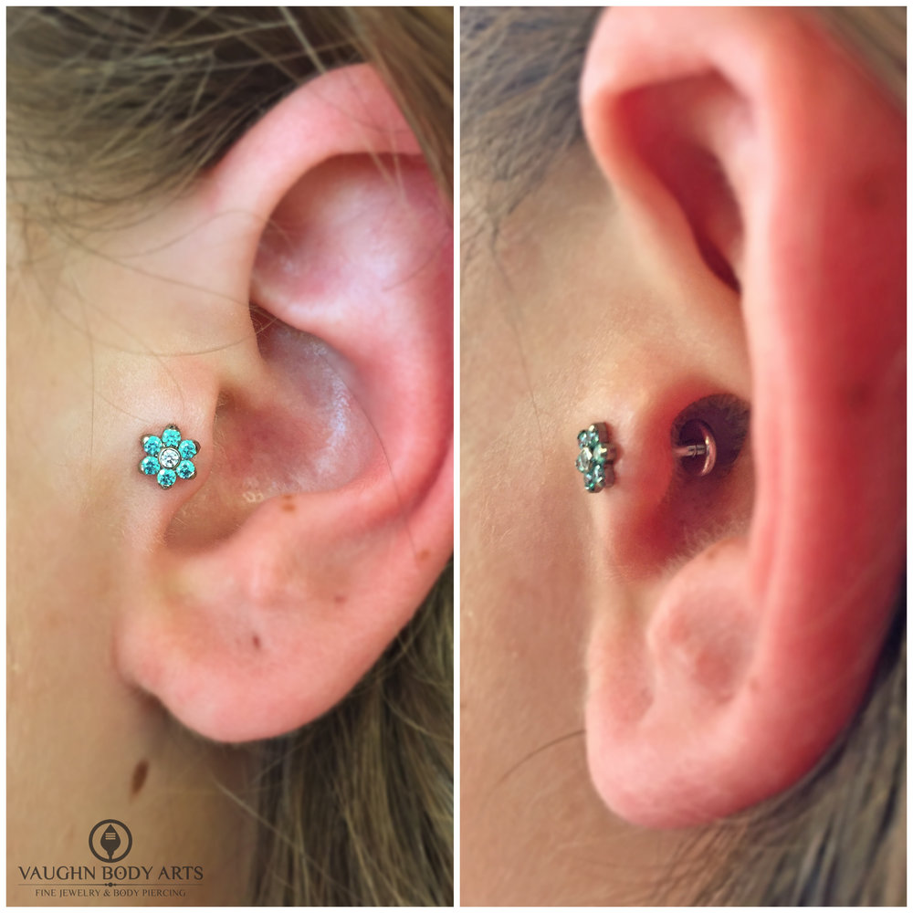Tragus piercing with titanium flower from Anatometal.