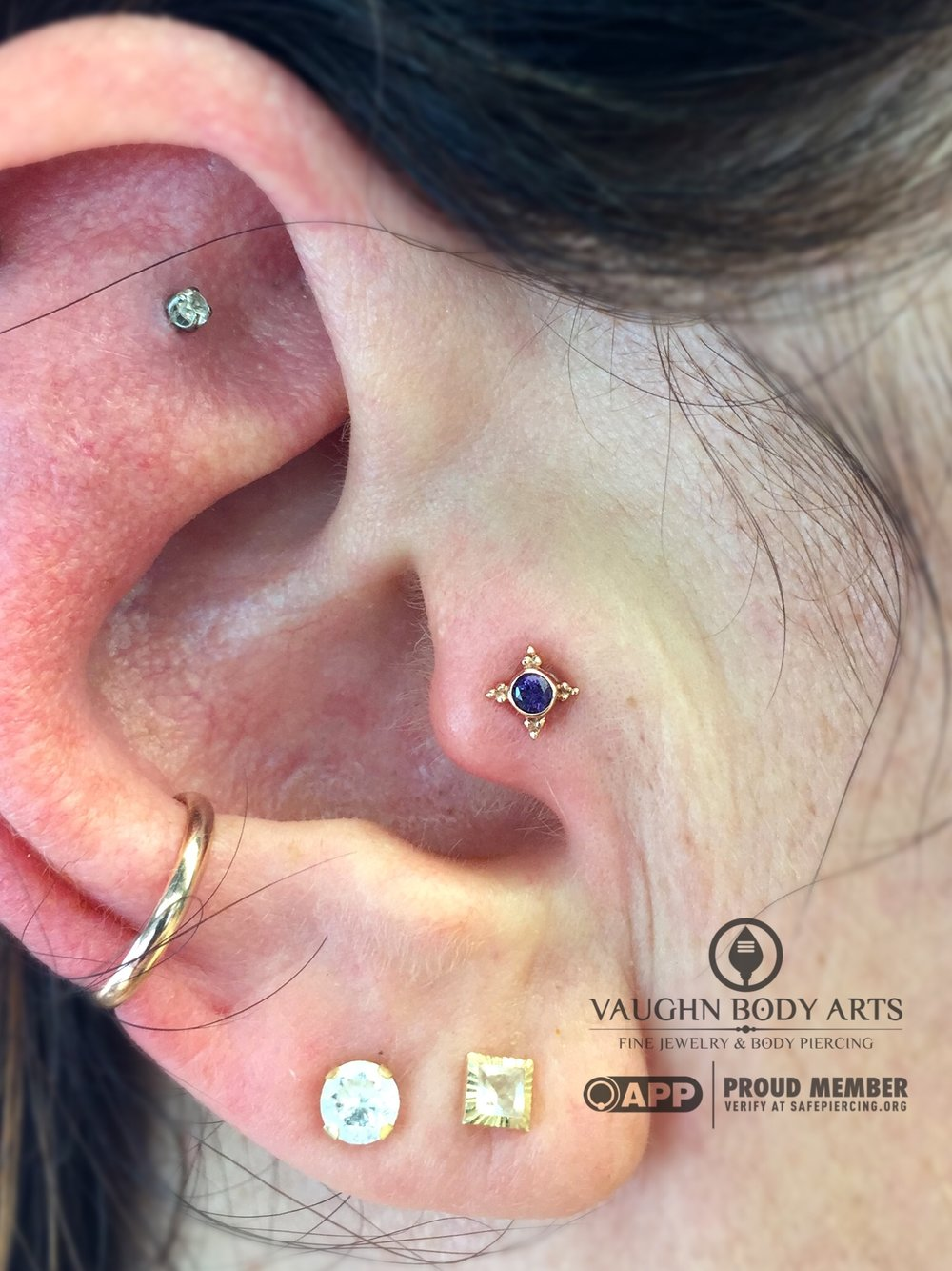 "Tragus piercing featuring a 14k rose gold and amethyst ""Mini Kandy"" end from BVLA."