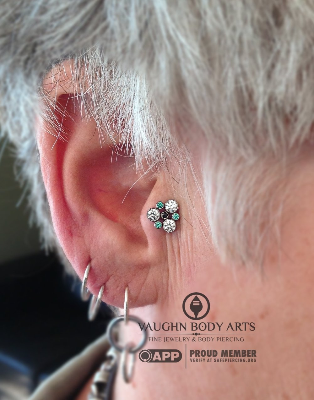 Tragus piercing with titanium gem cluster from Anatometal.