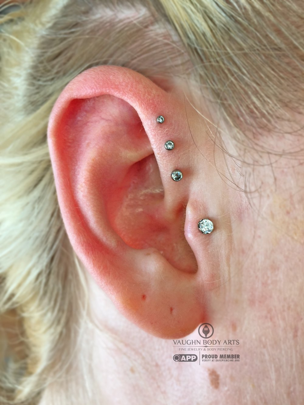 Triple forward helix piercings with titanium jewelry from NeoMetal.