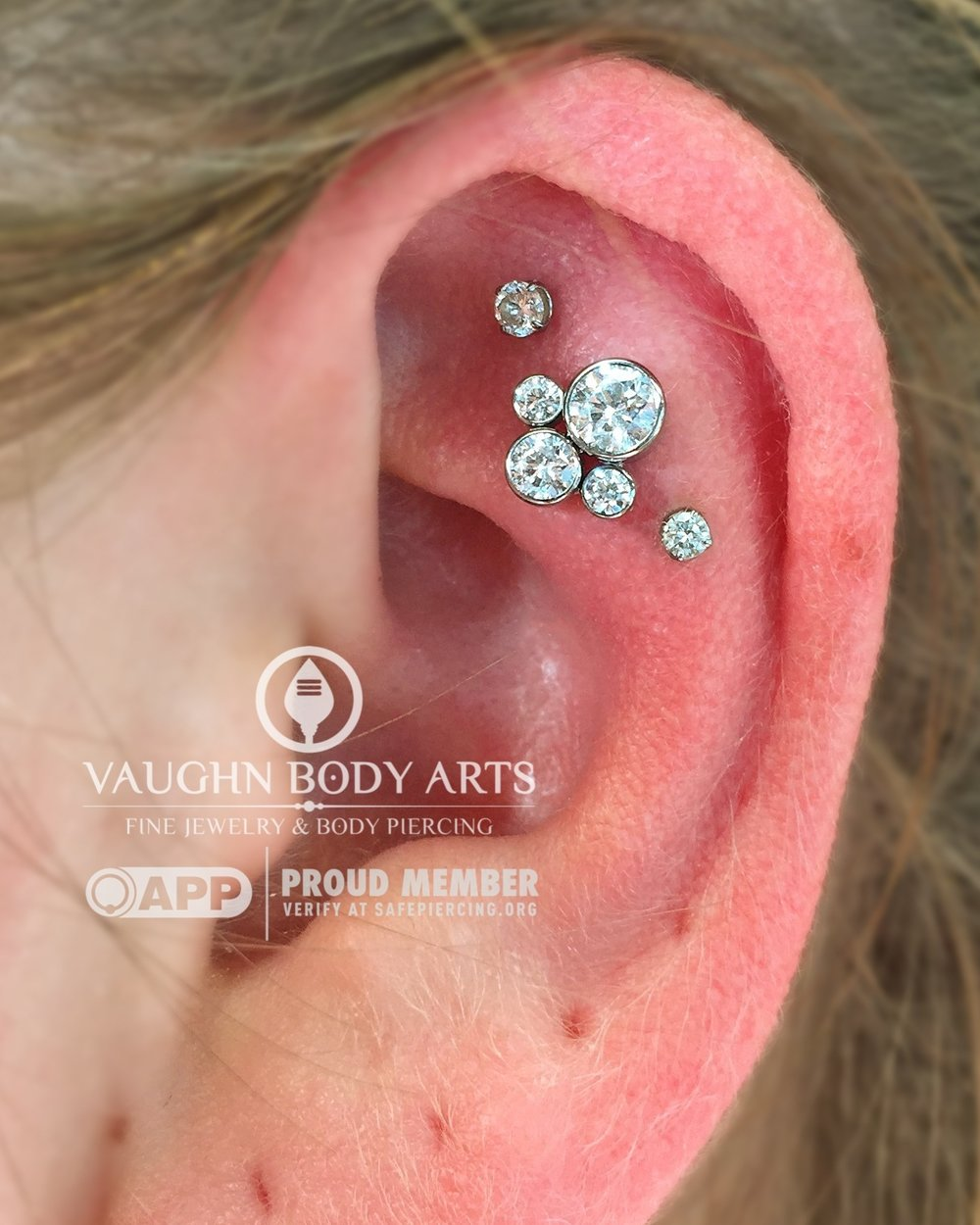 Triple helix piercings with titanium jewelry from NeoMetal and Anatometal.